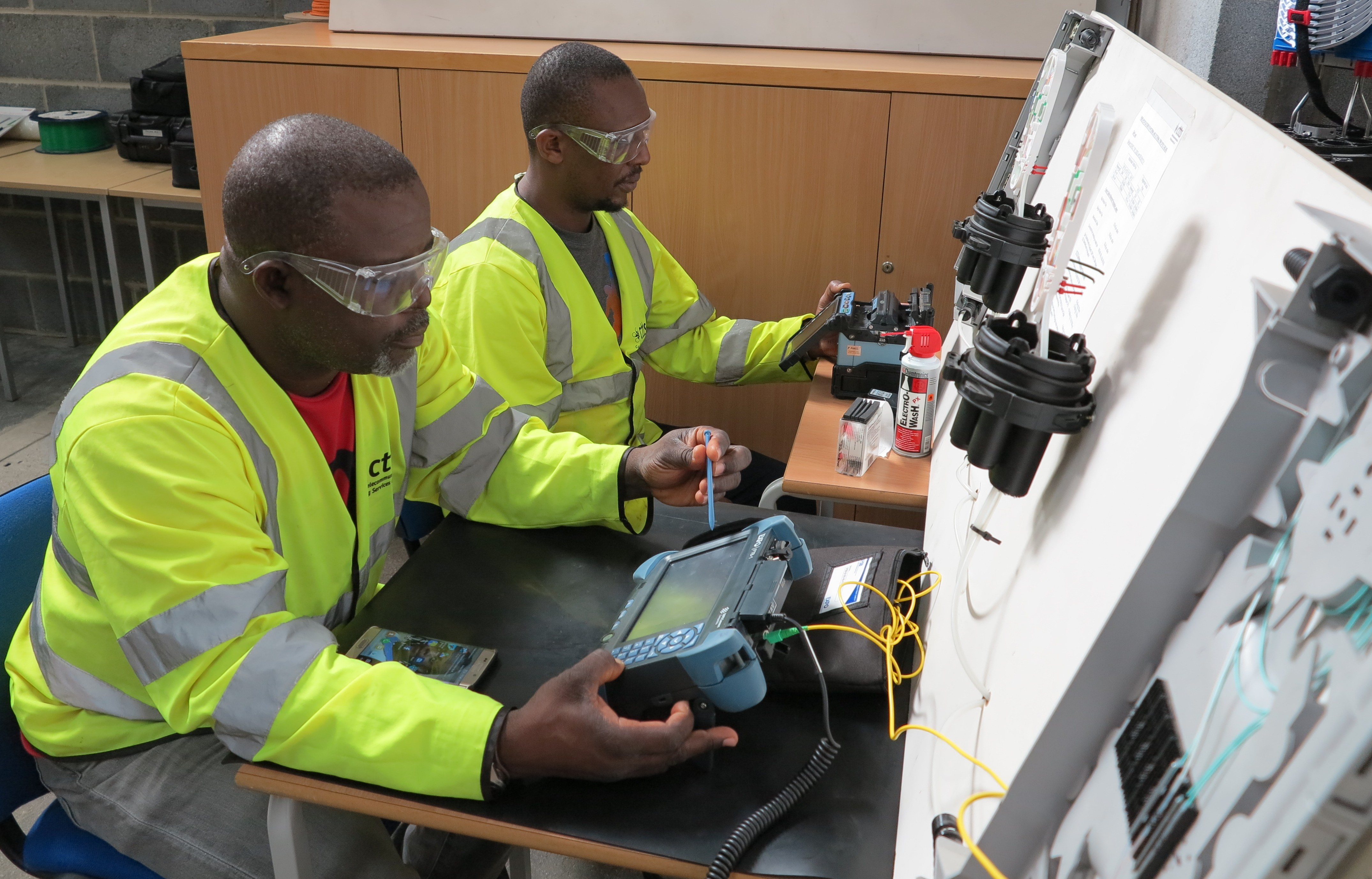Technical Director Rafi Mohammed and engineer Fikiri Mhango get to grips with optical test and measurement and fusion splicing technics leading to certified qualifications.